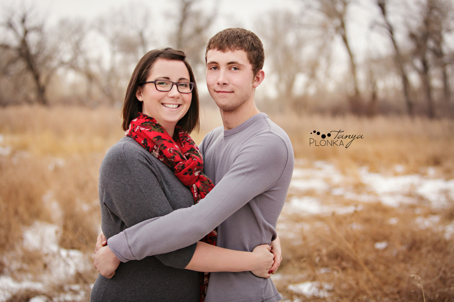 Family photos in Indian Battle Park, winter, Lethbridge. Brother and sister wearing red and gray colors.