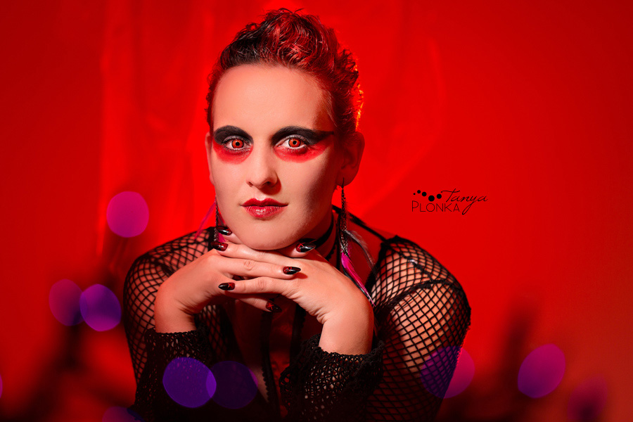 Alternative boudoir portraits of girl in red light, Lethbridge