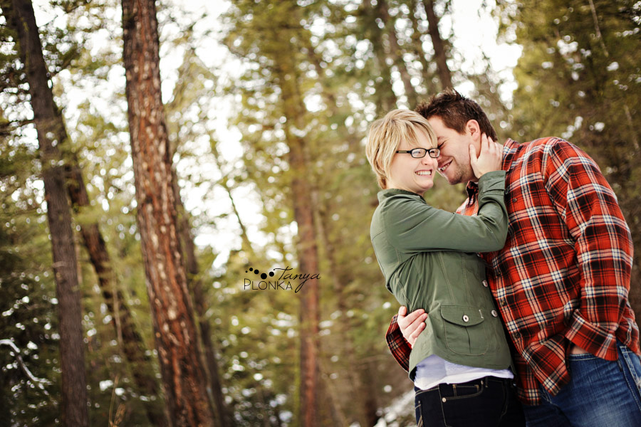 Engaged couple in winter in forest, engagement photography Crowsnest Pass