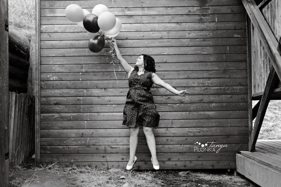 Lethbridge portrait photography, girl with balloons jumping