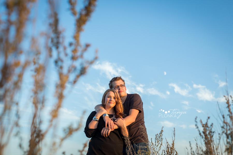 Lethbridge engagement photos, couple with black dog