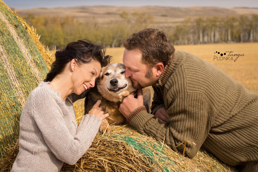 Beaver Mines couple photos on farm with dog, hugging dog