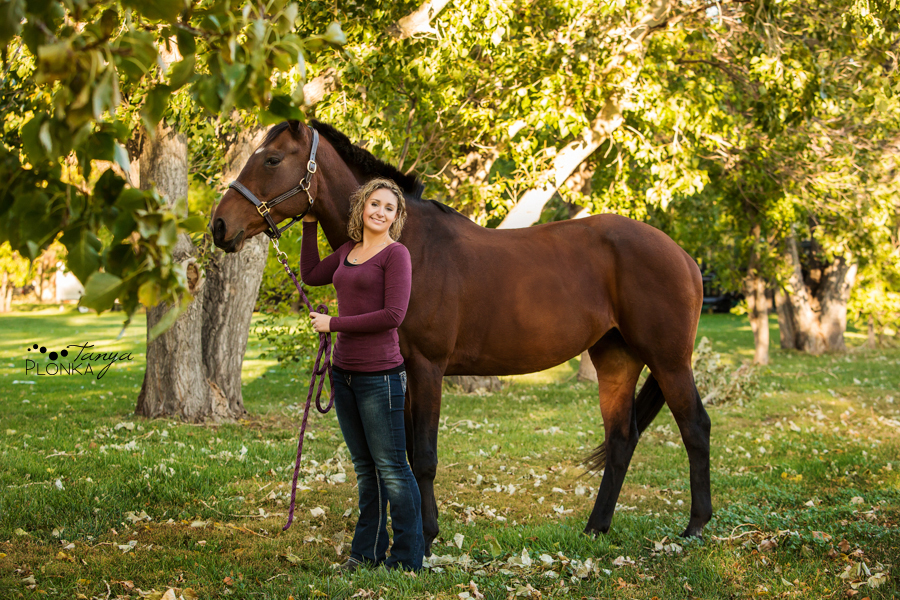 Young woman with brown horse in Lethbridge