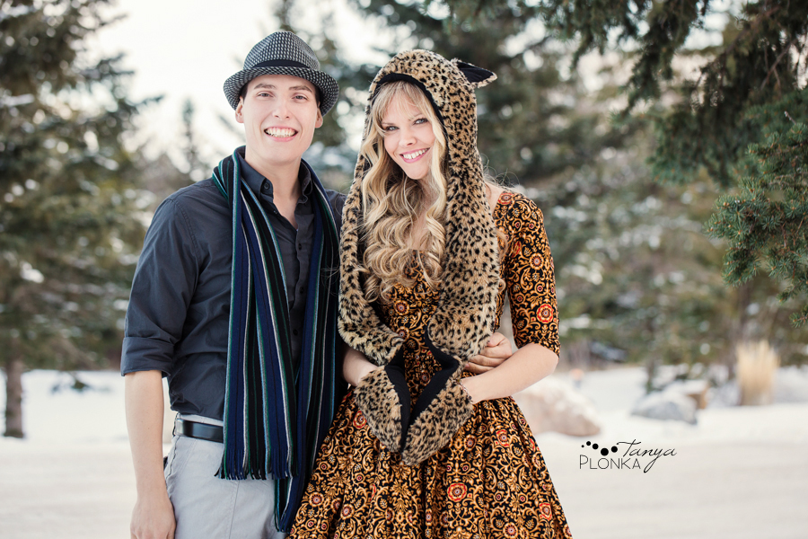 outdoor engagement photo with cute fur hat