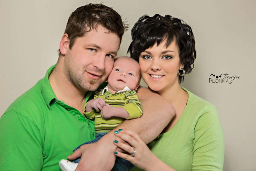 Happy family posing with newborn baby in Crowsnest Pass
