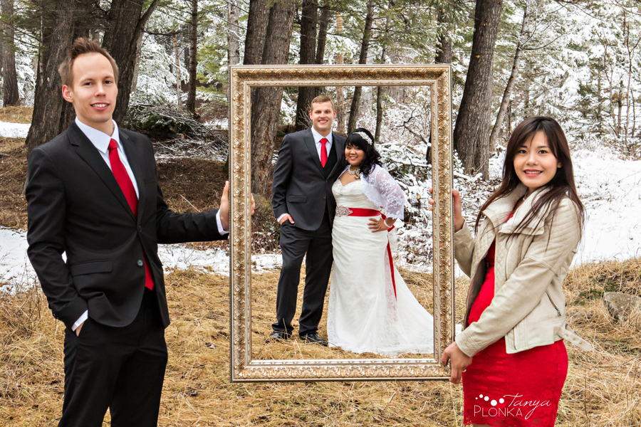 Michelle & Oscar, bride and groom in picture frame in Crowsnest Pass