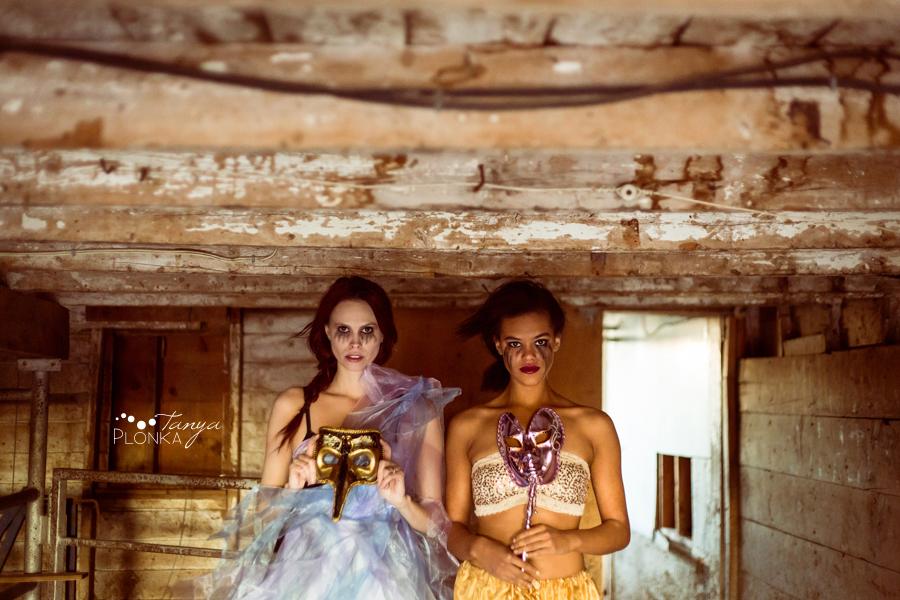 girls wearing masks in Lethbridge barn