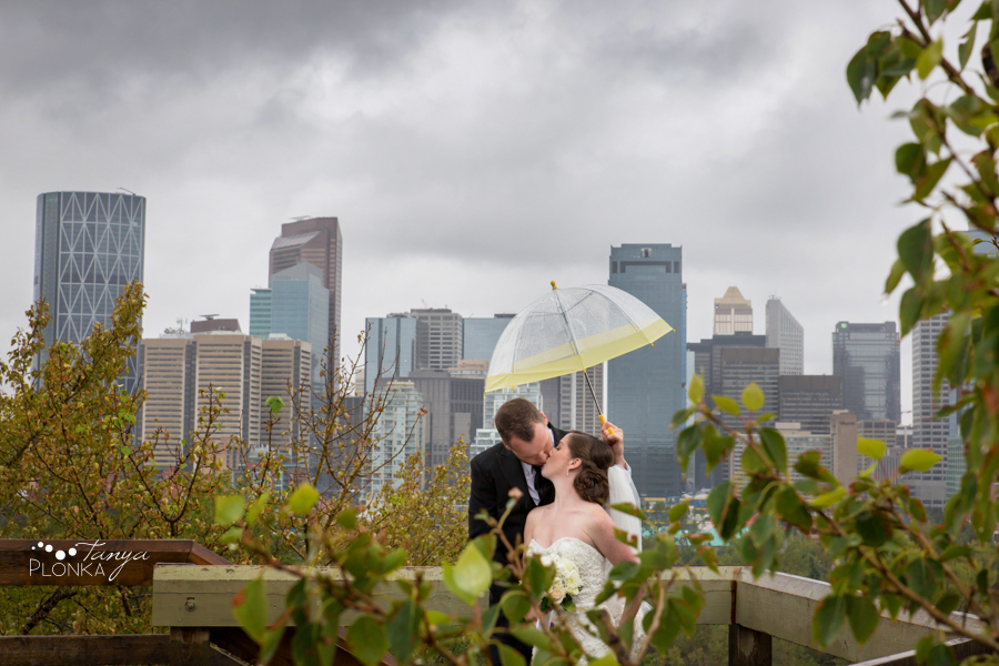 Evan & Emily, Calgary cityscape rainy outdoor wedding photography