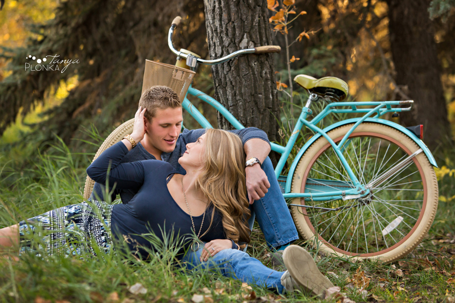 Park Lake fall engagement photos with bicycle