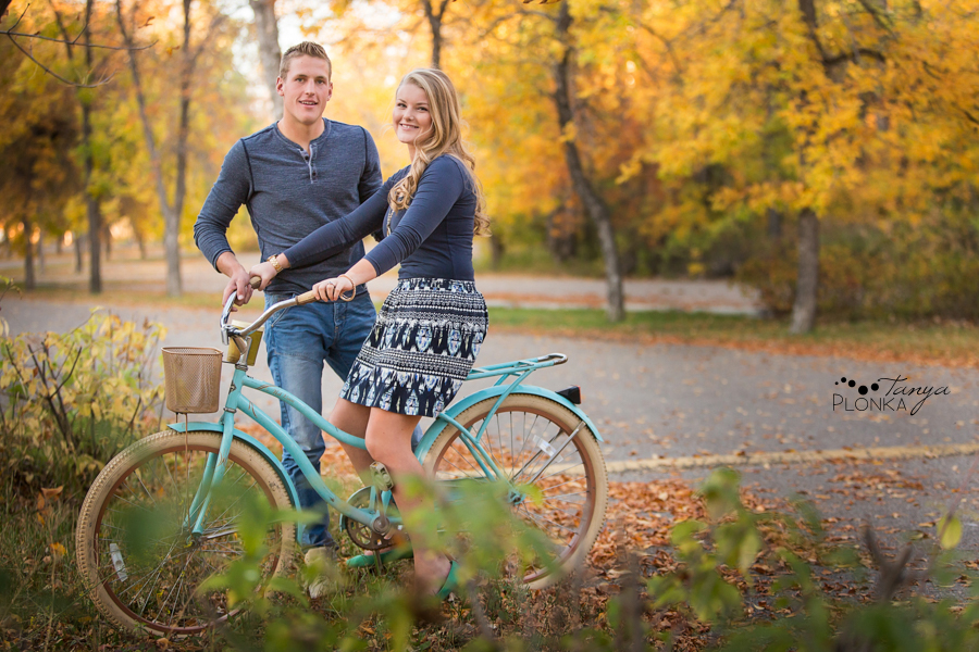 Park Lake autumn engagement photos with bicycle