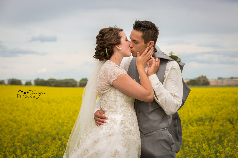 Jelaina & Daniel, wedding photos in canola field in Alberta