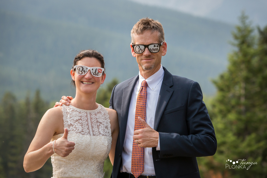 Ryan and Becky, silly bride and groom sunglasses