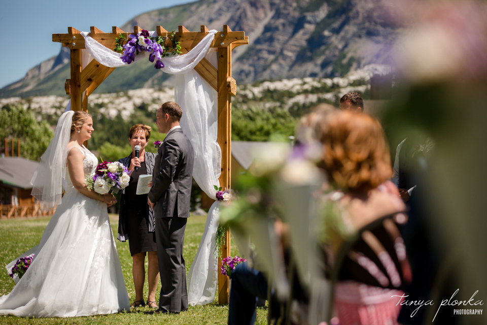 Jessica and Jordan, Waterton Community Hall outdoor wedding ceremony
