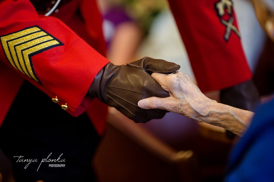 mountie holding old woman's hand