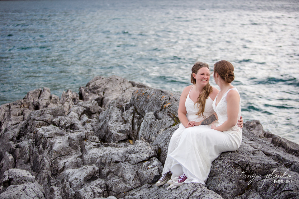Cassie and Chelsea, two brides on Waterton shoreline