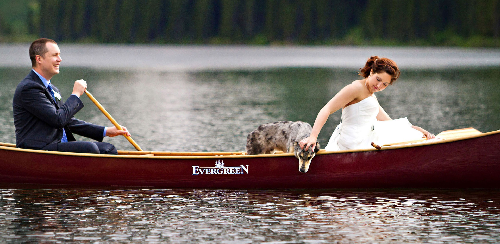Waterton Cameron Lake canoe wedding photo bride and groom with dog