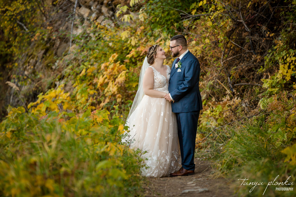 bride and groom in fall colours in Waterton