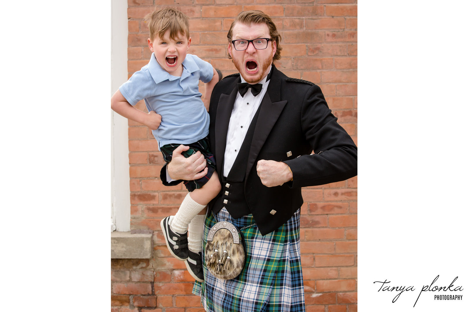 Dad and son wearing kilts at the Galt Museum yelling