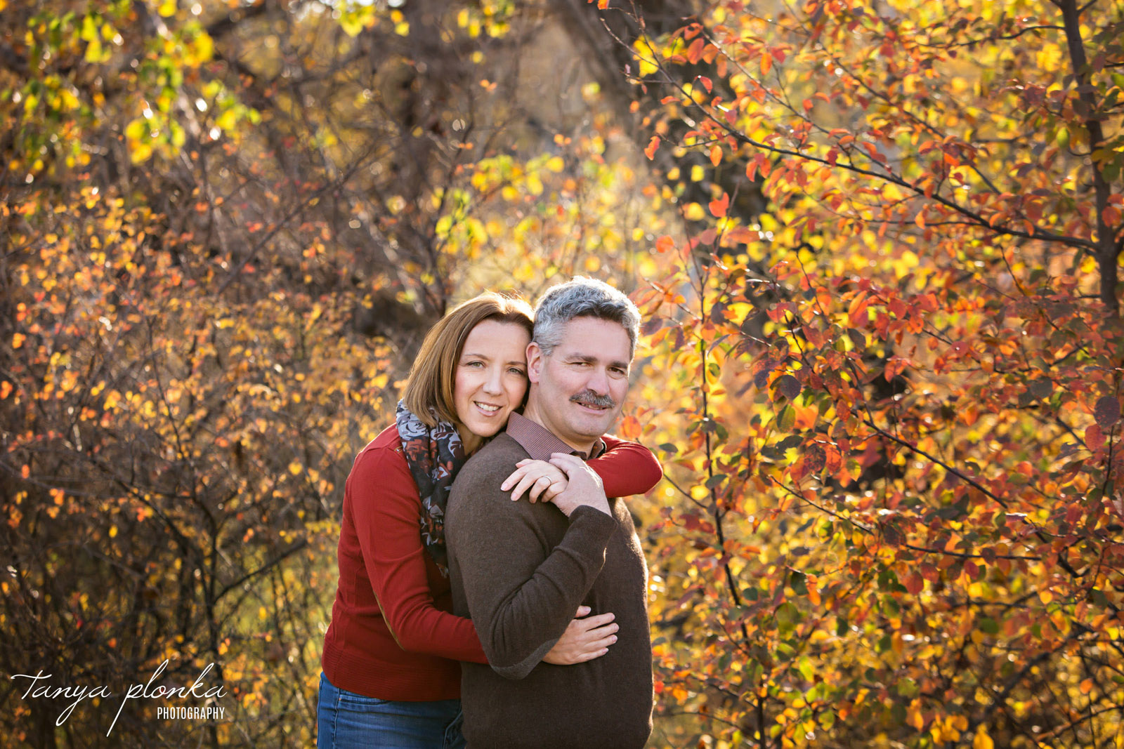 married couple embracing at Helen Schuler Nature Reserve in autumn