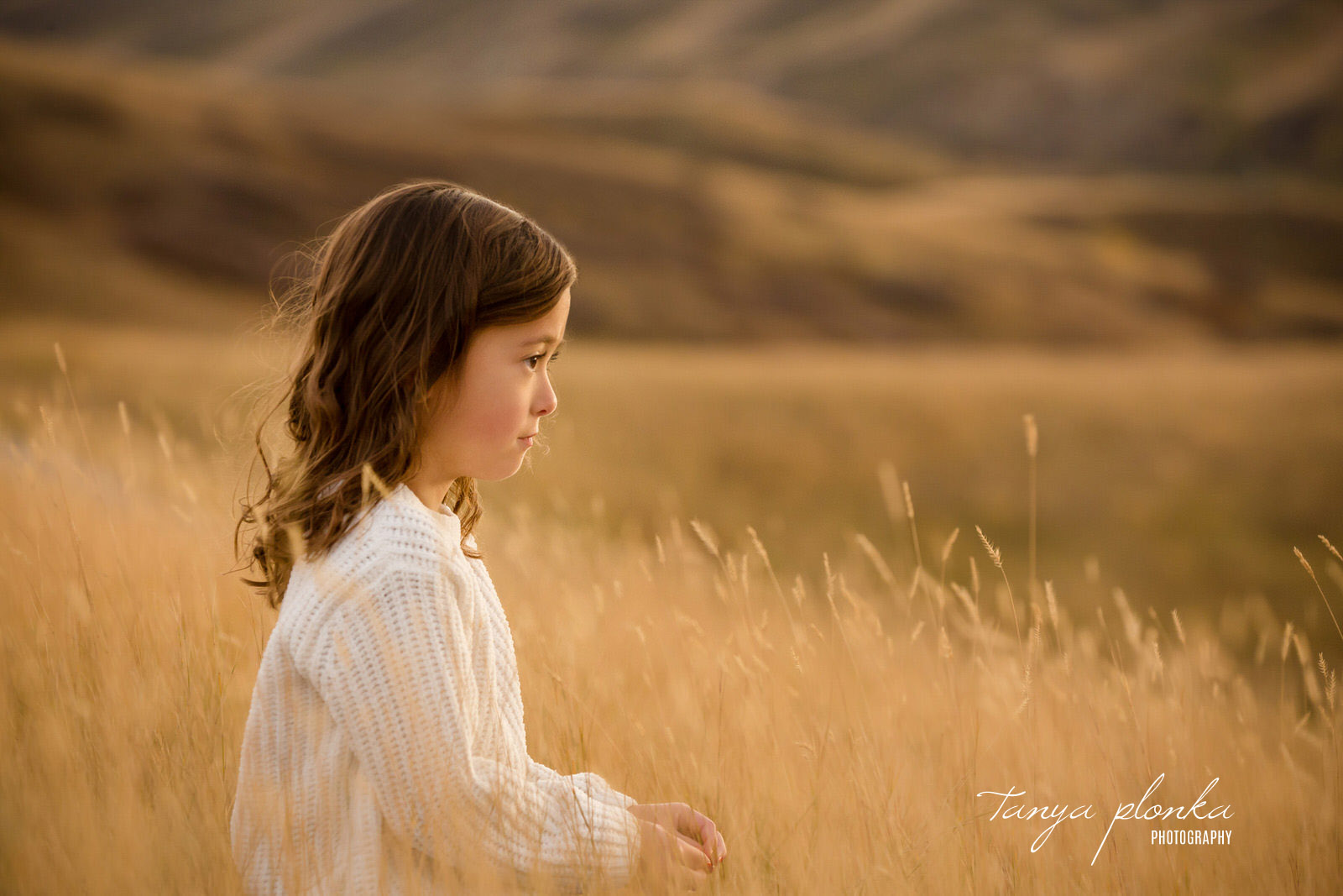 Girl looking over the Lethbridge coulees at sunset