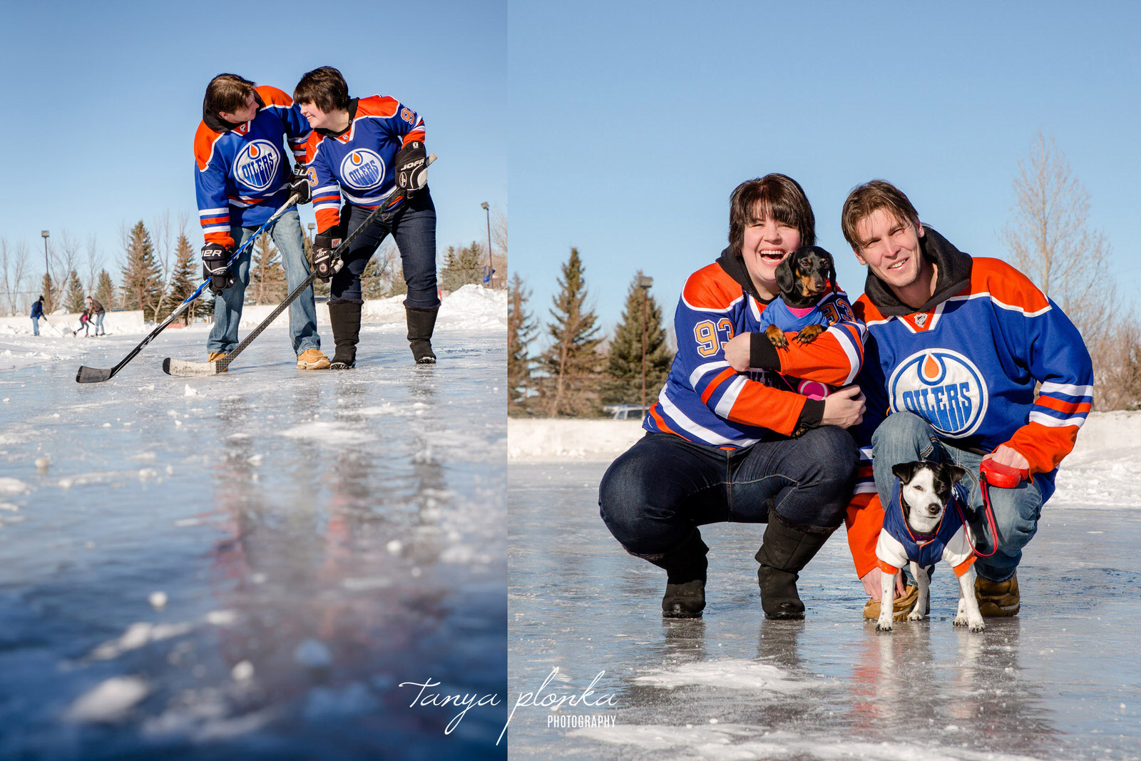 couple in Oilers jerseys pose on outdoor ice rink in Lethbridge with hockey sticks and two small dogs