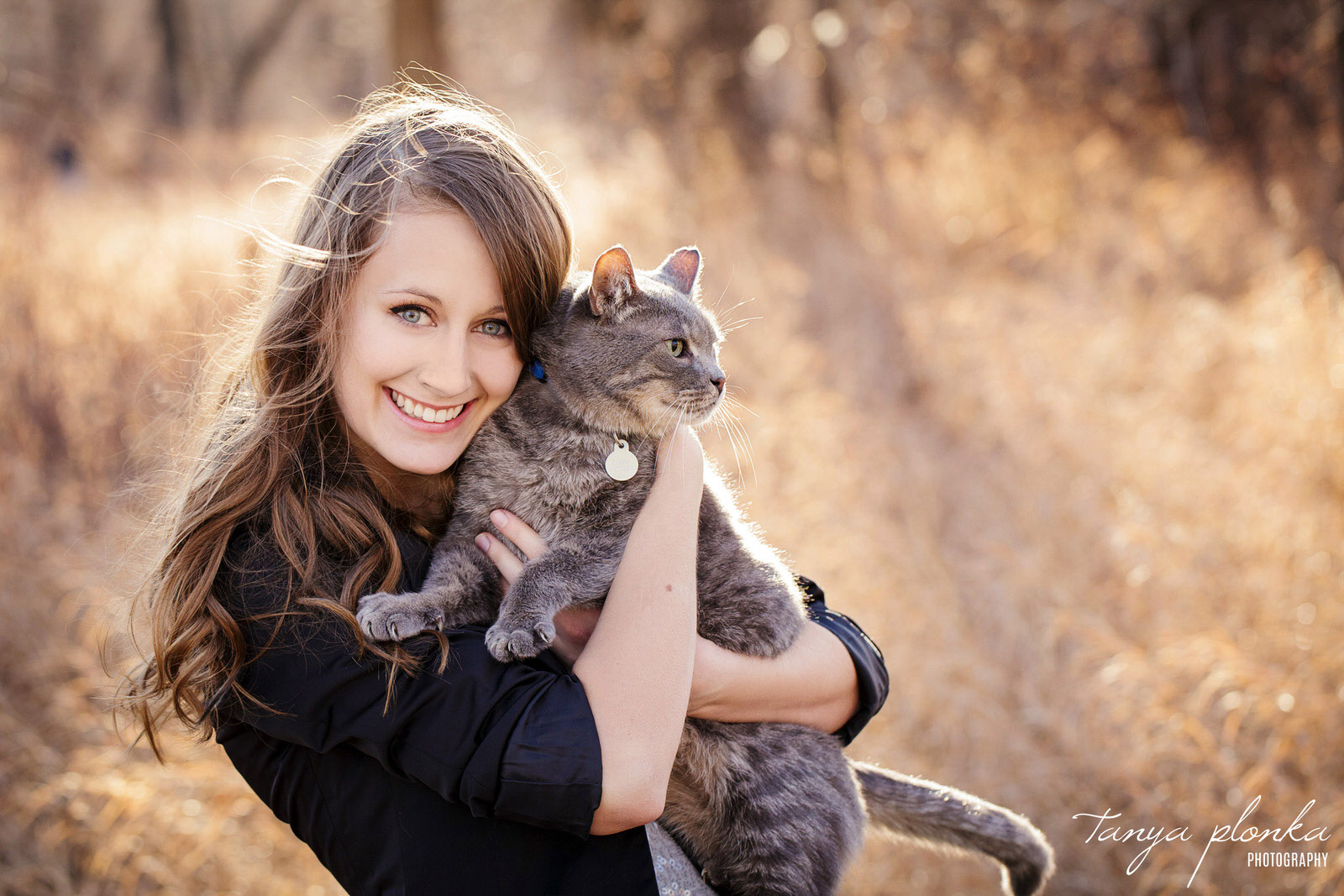 woman hugs gray tabby cat in Indian Battle Park