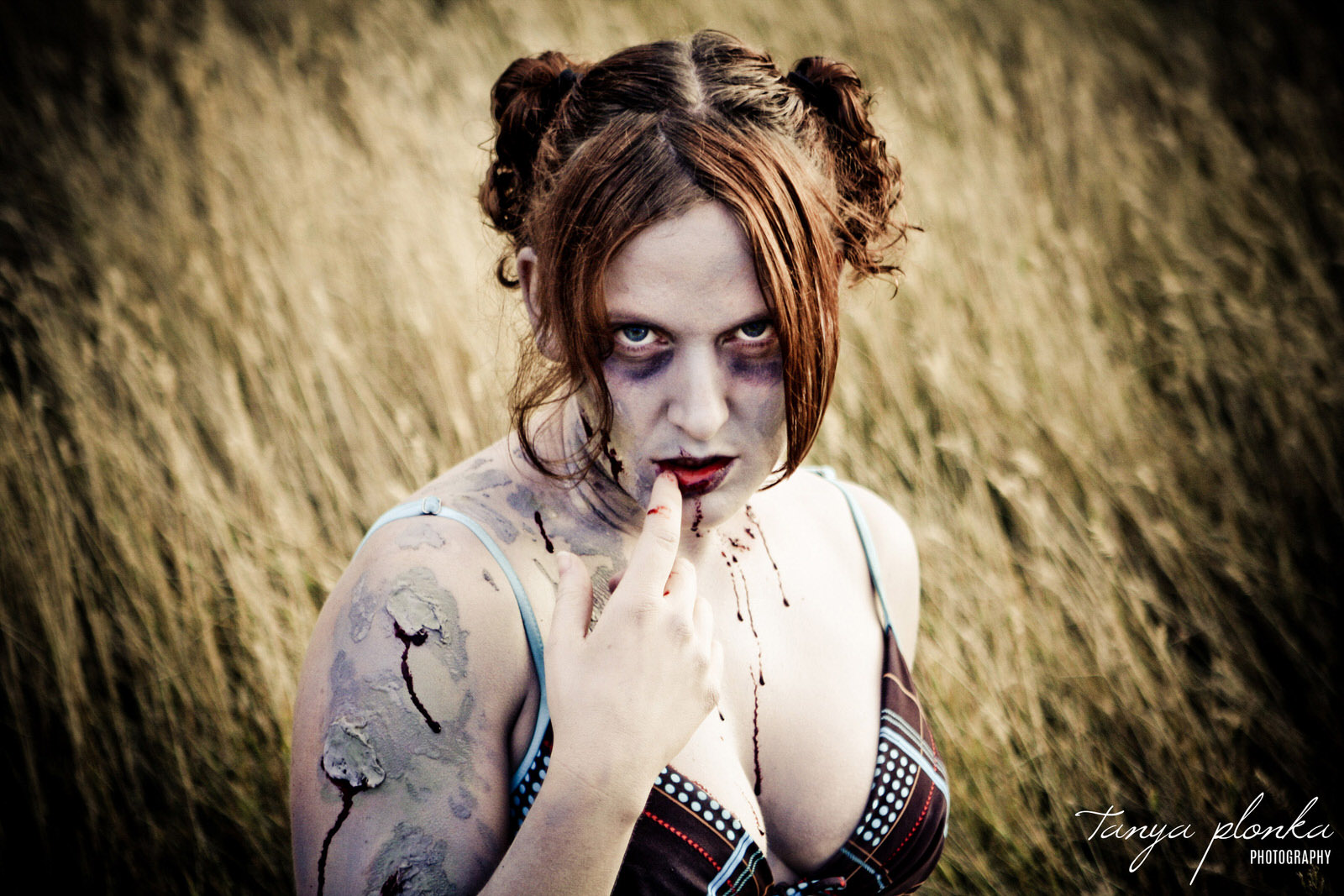 close up of zombie pinup with finger on lips