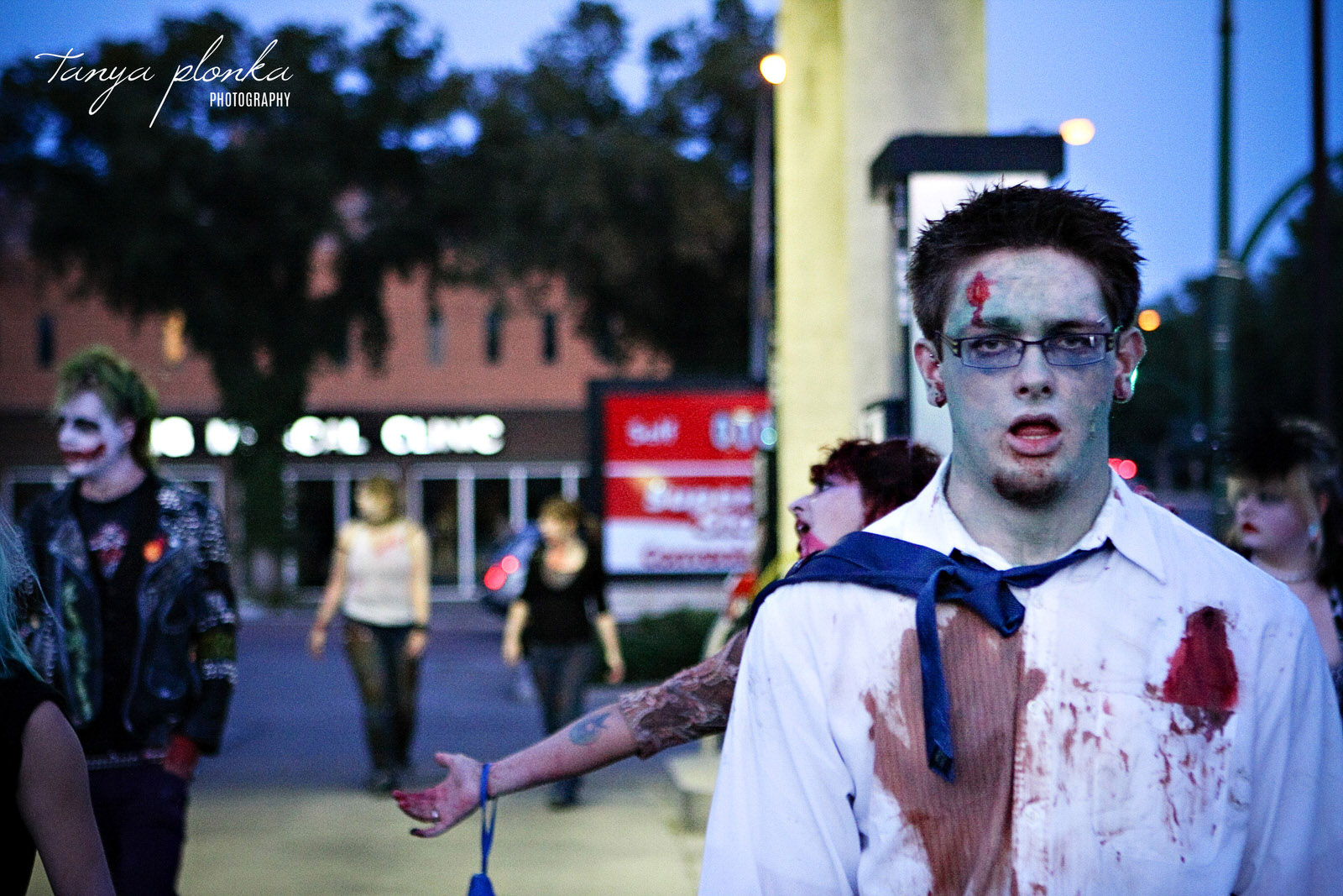 zombies pass through a Lethbridge gas station during the Zombie Walk
