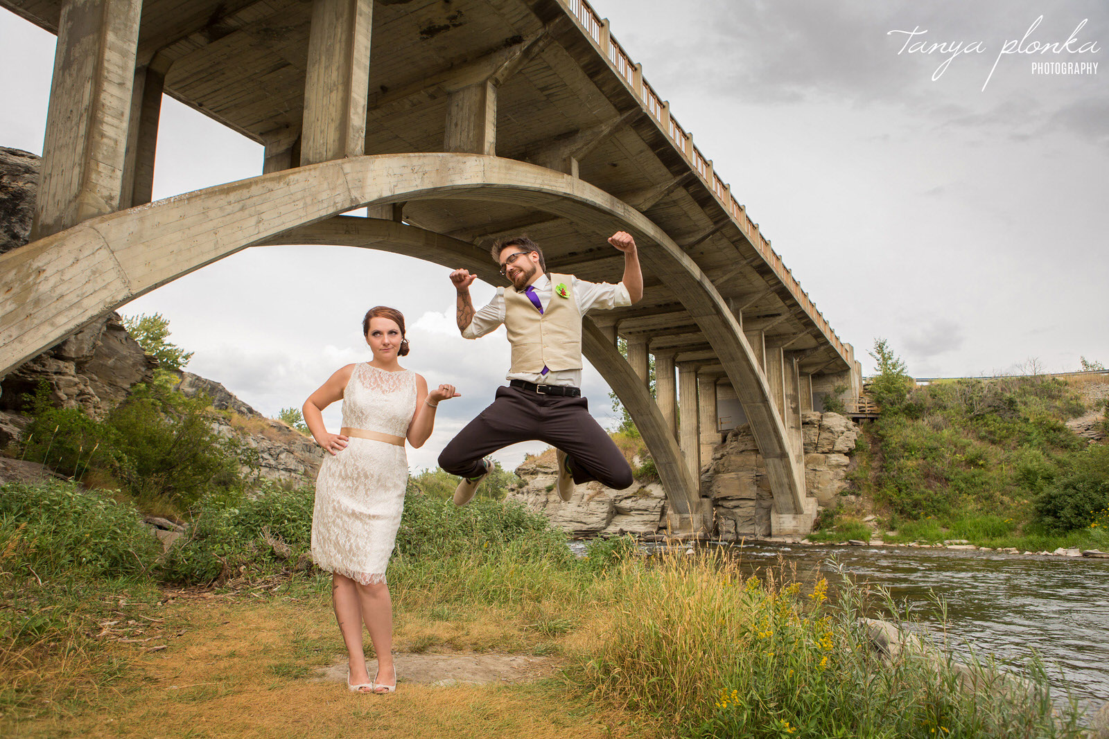 groom jumping at Lundbreck Falls bridge