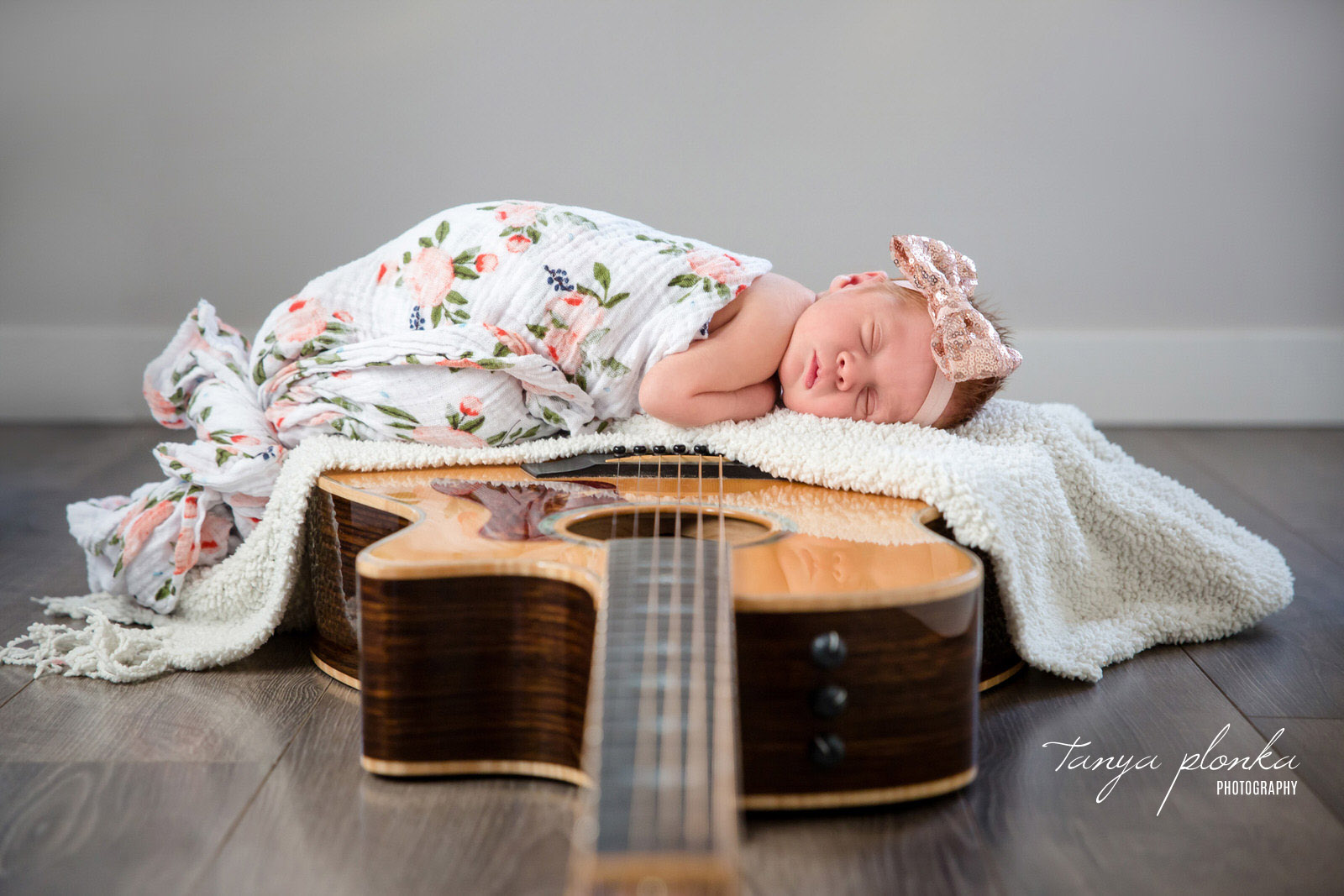 Baby sleeping on guitar
