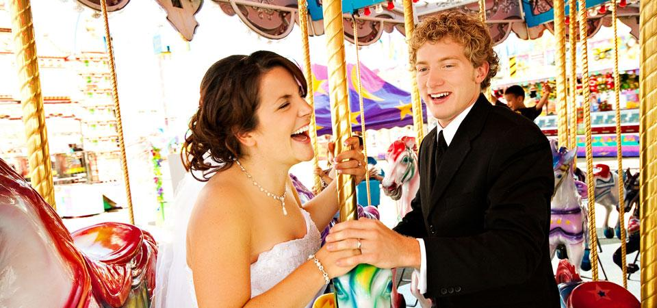 happy bride and groom on carousel during Whoop Up Days in Lethbridge