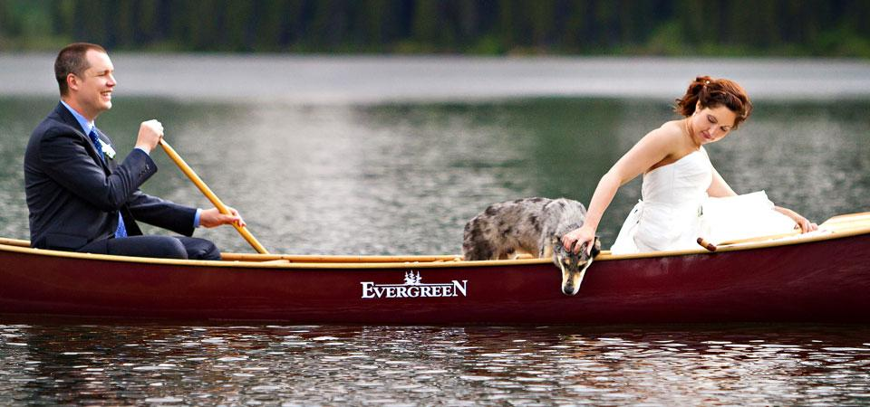 Cameron Lake canoe wedding photo with dog, Waterton bride and groom