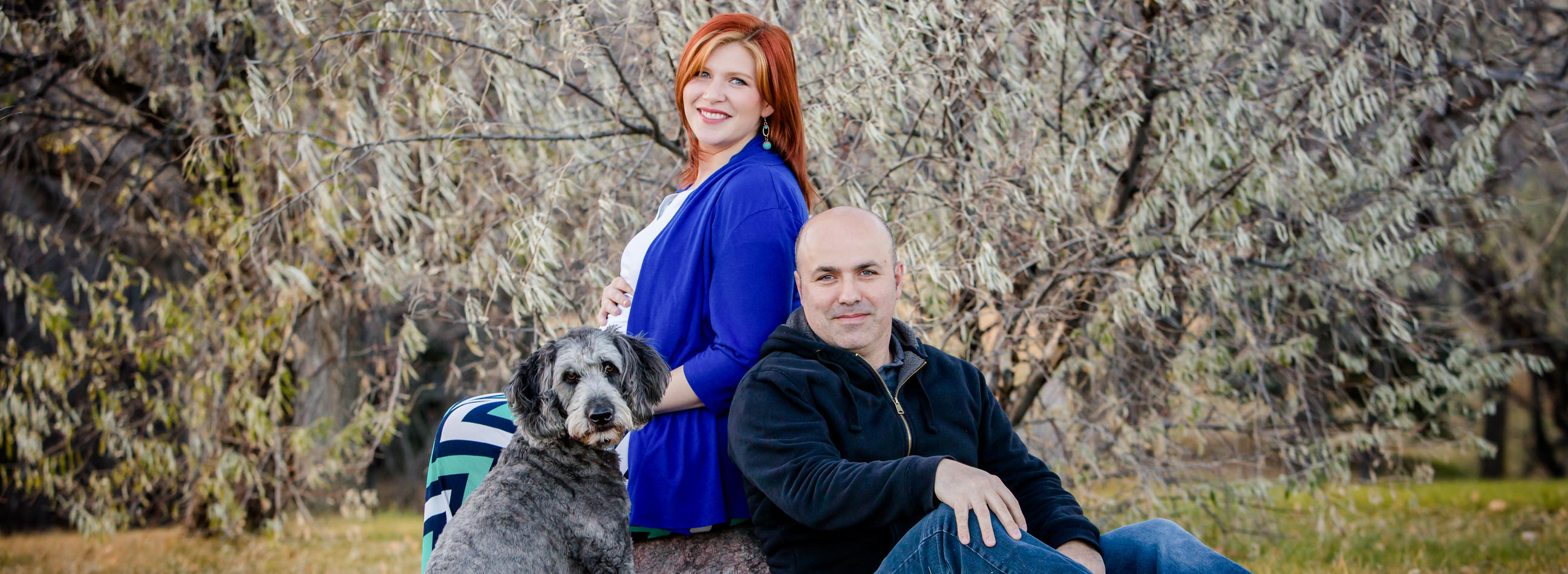 Kallie testimonial, early winter maternity photos with husband and pet dog