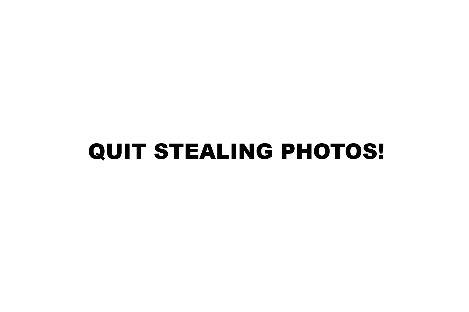little girl in plaid shirt crouching in green leaves resting head on hands