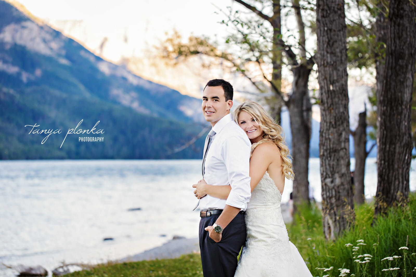 wedding couple snuggling in Waterton Lakes Park